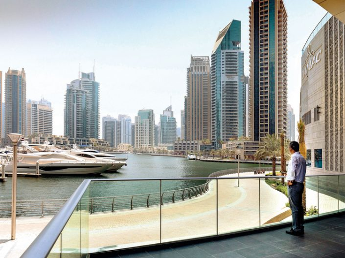 Adel_Sheni_enjoys_the_view_from_his_Dubai_Marina_apartment_tower